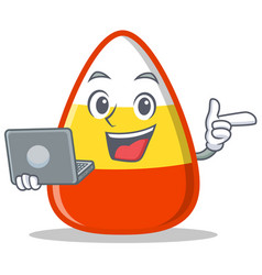 With laptop candy corn character cartoon vector
