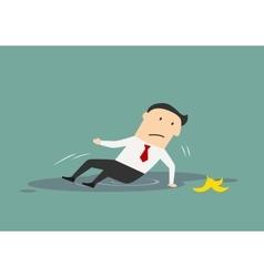 Businessman slipped on a banana vector