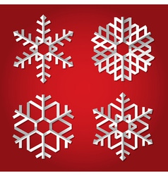 Christmas origami snowflakes on red background vector image