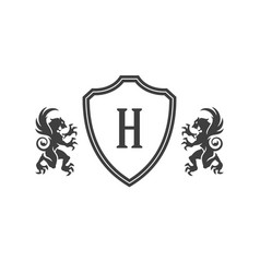 heraldic lions and monogram on shield isolated vector image