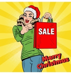 Pop art woman with christmas sale shopping bags vector