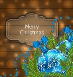 wooden label with Christmas balls and fir twigs vector image