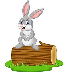 cartoon rabbit sitting on a log vector image