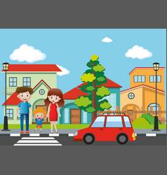 Family crossing street in village vector