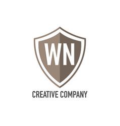 Initial letter wn shield design loco concept vector