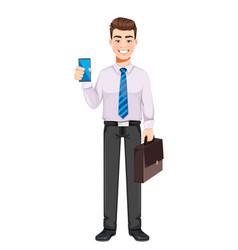 Handsome business man holding smartphone vector