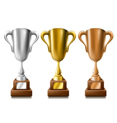 Gold silver and bronze trophy set vector image
