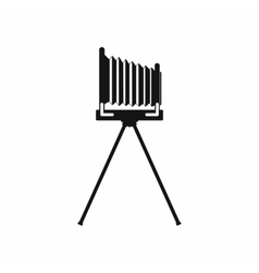 Old photo camera with tripod icon simple style vector image