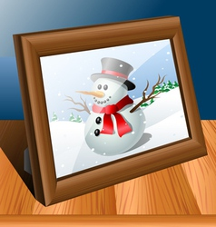 Photo frame on table vector image
