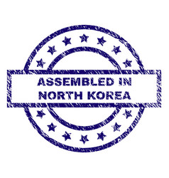 scratched textured assembled in north korea stamp vector image