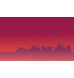 Silhouette of city on purple backgrounds vector