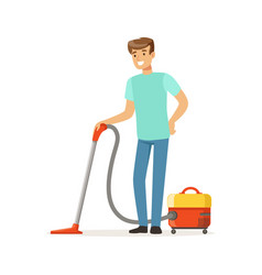 young smiling man cleaning the floor with vacuum vector image