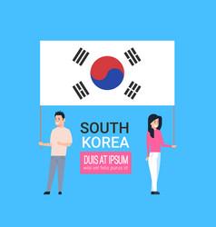 Young couple holding korean flag south korea man vector
