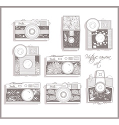 retro photo cameras set with floral pattern vector image vector image
