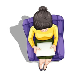 A topview of a woman reading while sitting down vector image