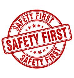 Safety first red grunge round vintage rubber stamp vector