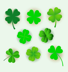 set of green clover leaves isolated on white backg vector image