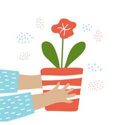 Hands hold a pot with a flower vector