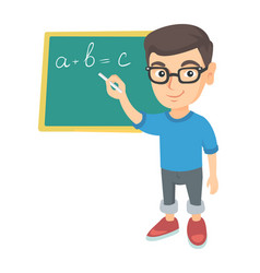 caucasian schoolboy writing on the blackboard vector image