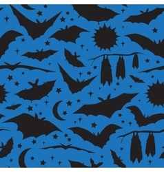 Seamless pattern with bats on blue background vector image