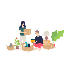 a girl and a young man unpacking household items vector image