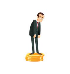 sad businessman on stack of money vector image