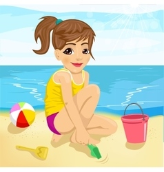 cute little girl playing with sand on beach vector image vector image