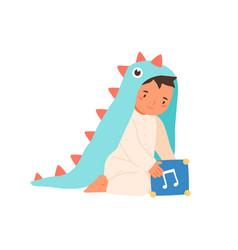 Cute little boy wearing dinosaur costume playing vector
