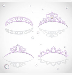 Shining elegant violet tiaras with diamonds and vector