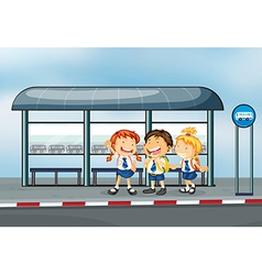 Students at the bus stop vector