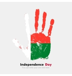 Handprint with the Flag of Madagascar in grunge vector