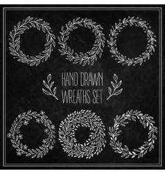 set decorative wreaths drawn in chalk on a vector image