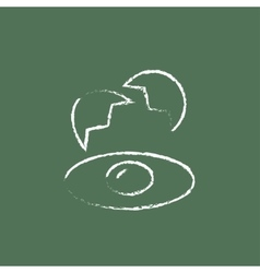 Broken egg and shells icon drawn in chalk vector
