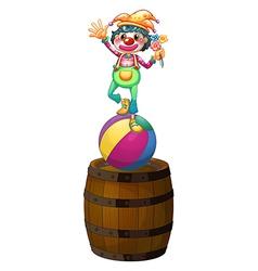 A playful clown above wooden barrel vector