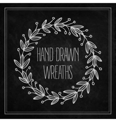 Decorative wreaths drawn in chalk on a blackboard vector image