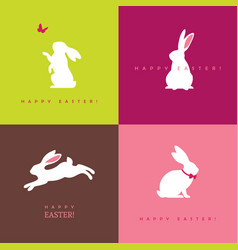 four white bunny silhouettes vector image