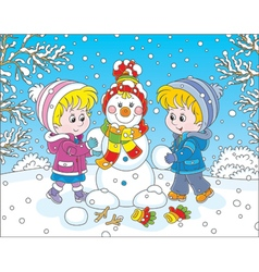 Children making a Christmas snowman vector image