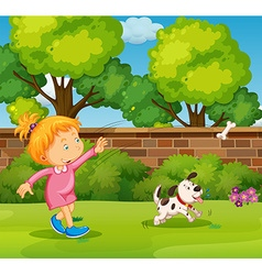 Girl playing with pet dog in yard vector