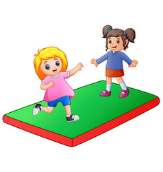 Two little girl playing on the mat vector