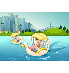 Children riding on duck boat in the lake vector image vector image