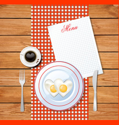 Heart shaped omelet on white plate and cup of vector