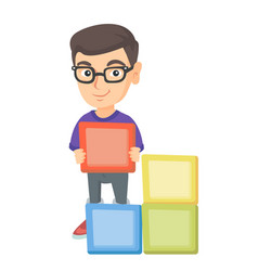 little caucasian boy playing with clourful cubes vector image