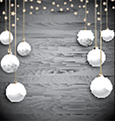 Hanging Christmas baubles on a wooden background vector image