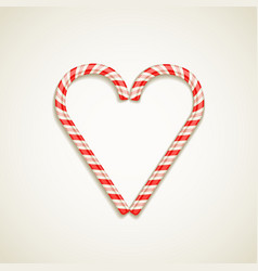 Candy canes shape of heart vector