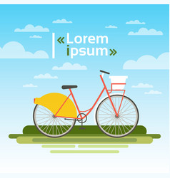 Bicycle outdoors on green grass over blue sky no vector