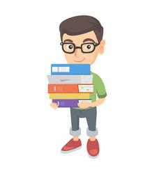 caucasian school child holding pile of textbooks vector image