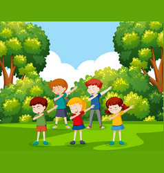 A group of children dancing at the park vector