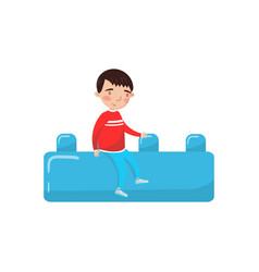 cute little boy sitting on a giant blue buiding vector image