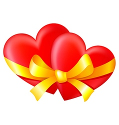 Two hearts tied with a gold ribbon with a bow vector