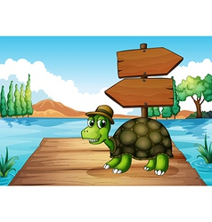 A turtle near the wooden arrowboard vector image vector image